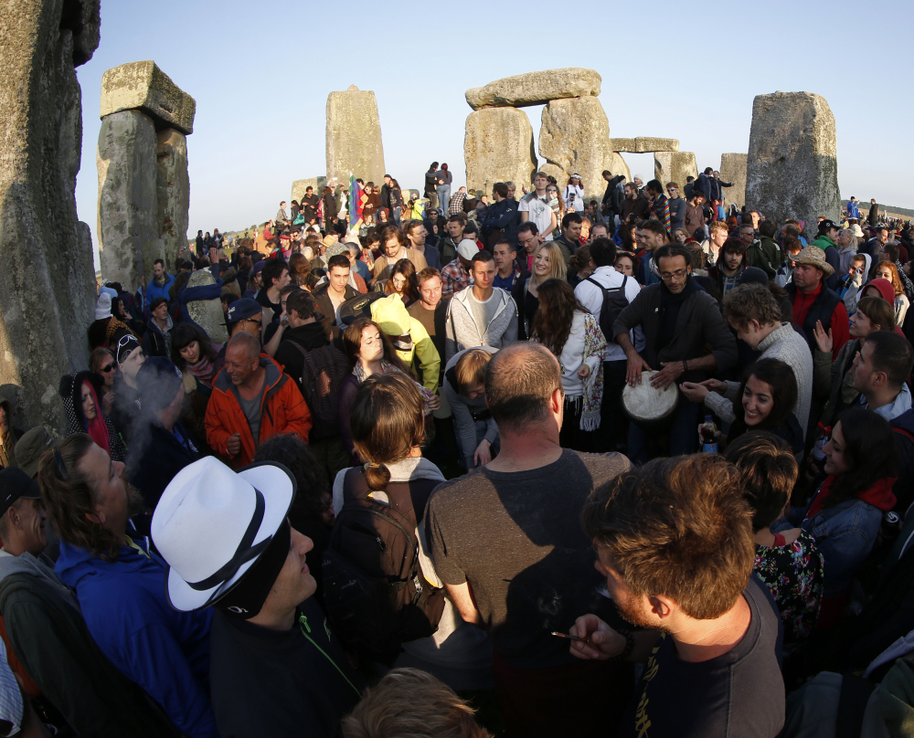Thousands of revelers gather Saturday at Stonehenge near Salisbury, England, to celebrate the summer solstice.