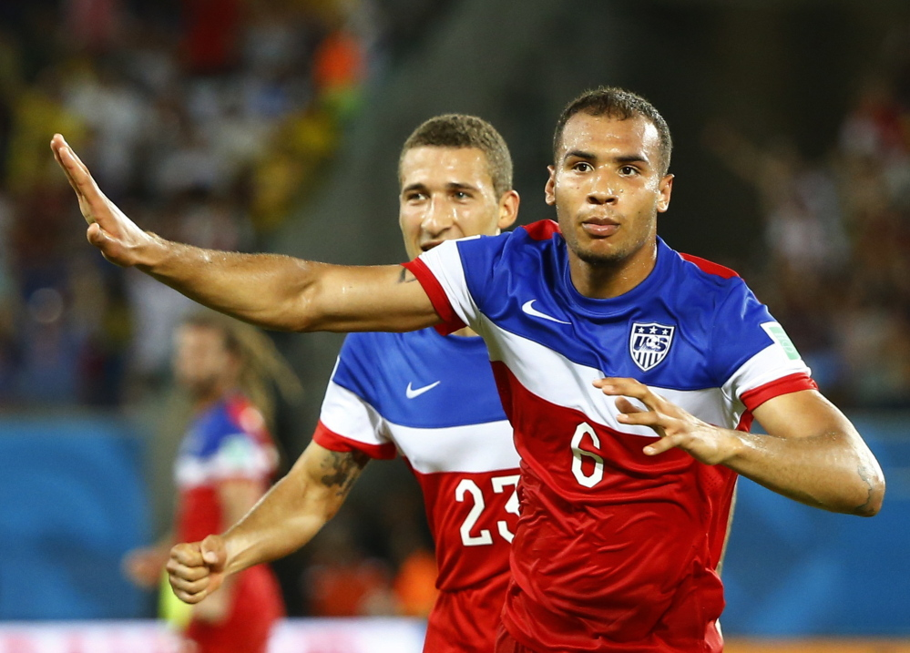John Brooks of the United States celebrates his goal against Ghana with teammate Fabian Johnson last week during their 2014 World Cup Group G game in Natal, Brazil. Nike, which outfits the U.S. team, touts its Dri-FIT technology in its jerseys for improved breathability.