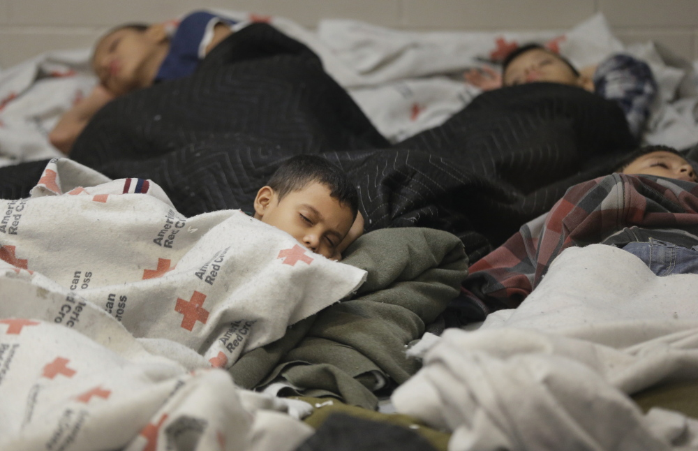 Child detainees sleep in a holding cell at a U.S. Customs and Border Protection processing facility in Brownsville, Texas. Thousands of immigrant children are crossing alone into the United States.