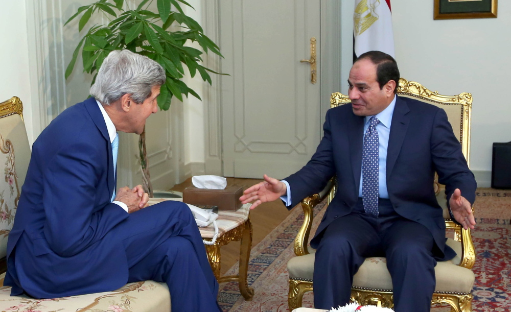 U.S. Secretary of State John Kerry, left, talks with Egypt's President Abdel-Fattah el-Sissi at the presidential palace in Cairo, Egypt, on Sunday.