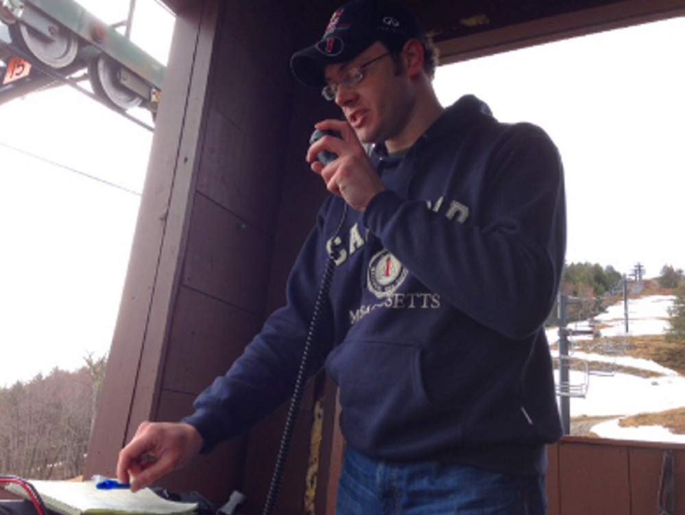 Ham radio operator Thom Watson attempts to make radio contact during a summit transmission event on Pleasant Mountain. Photo courtesy Tim Watson