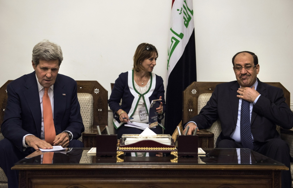 U.S. Secretary of State John Kerry meets with Iraqi Prime Minister Nouri al-Maliki at the prime minister's office in Baghdad on Monday. Iraqi officials briefed on the talks said al-Maliki urged the United States to target the militants' training camps and convoys  in Iraq and neighboring Syria with airstrikes.