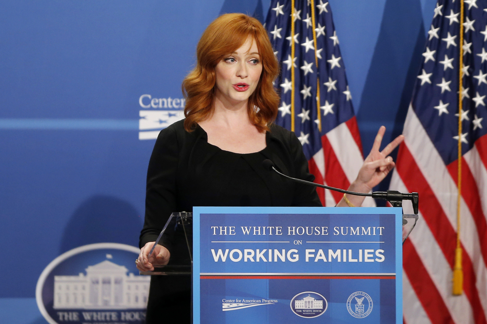 "Actress Christina Hendricks, known for her role in the television series ""Mad Men,"" speaks at The White House Summit on Working Families, Monday in Washington. The gathering, organized by the White House, Department of Labor, and the Center for American Progress, highlights the challenges and offers solutions faced by working families in America."