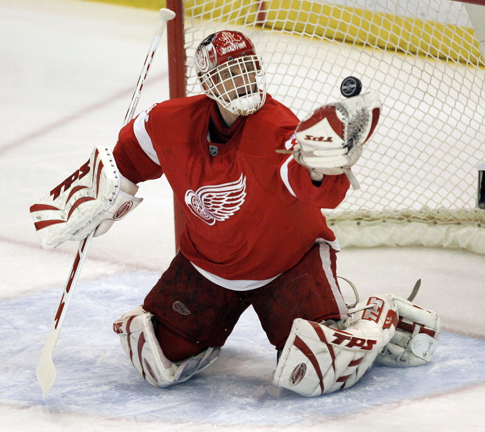 The Associated Press In this April 3, 2008 file photo, Detroit Red Wings goalie Dominik Hasek, of the Czech Republic, stops a Columbus Blue Jackets' Rick Nash shot in the first period of an NHL hockey game in Detroit.