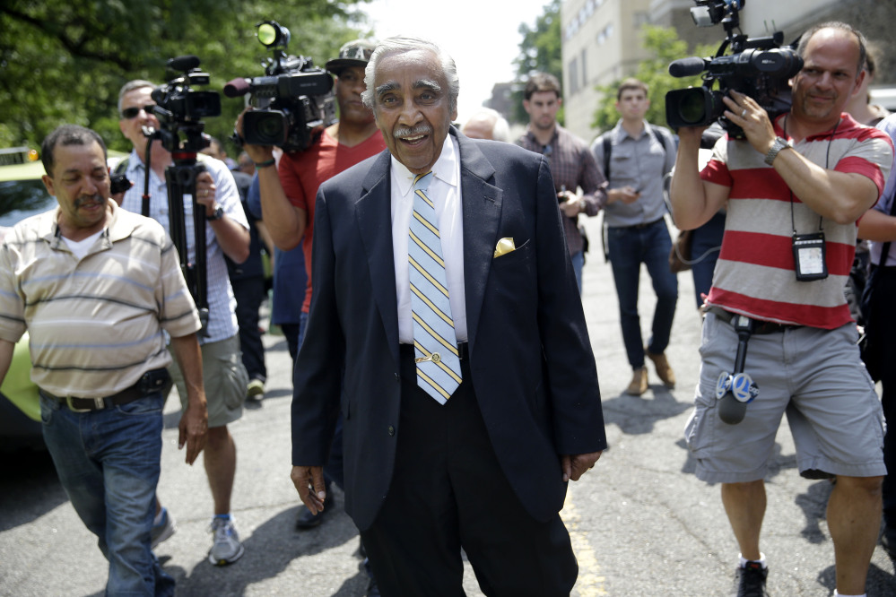 Congressman Charles Rangel is followed by reporters in New York, Monday, June 23, 2014. With Primary Day just a day away, longtime congressman Rangel says he's not overconfident he'll prevail over his closet rival — but insisted that voters would stick with a veteran lawmaker, dismissing criticism that he was too old to continue serving in Washington.