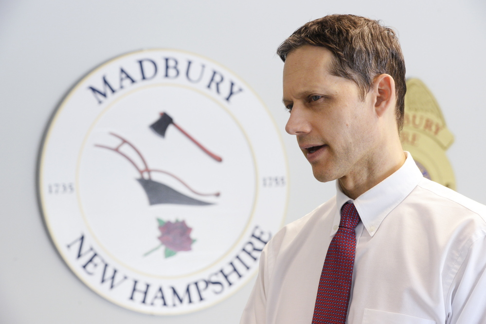 New Hampshire Assistant Attorney General Jeffery Strelzin, chief of the homicide unit, talks with a reporter at the Madbury, New Hampshire, Police Department on Monday.