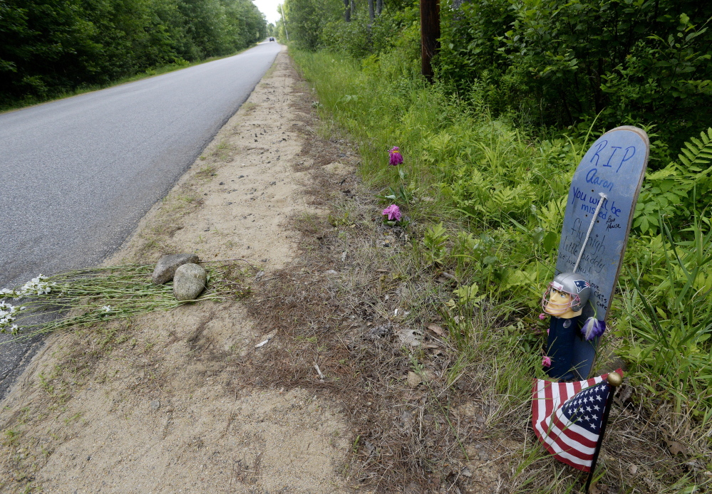 A makeshift memorial stands along Long Swamp Road in Lebanon on Monday. Police have identified a man who was found fatally stabbed in Lebanon on Saturday as Aaron Wilkinson. Shawn Patrick Ouellette/Staff Photographer