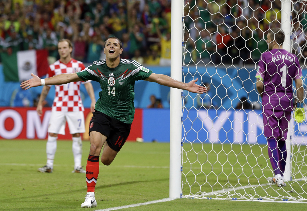 Mexico's Javier Hernandez celebrates after scoring his teams third goal.