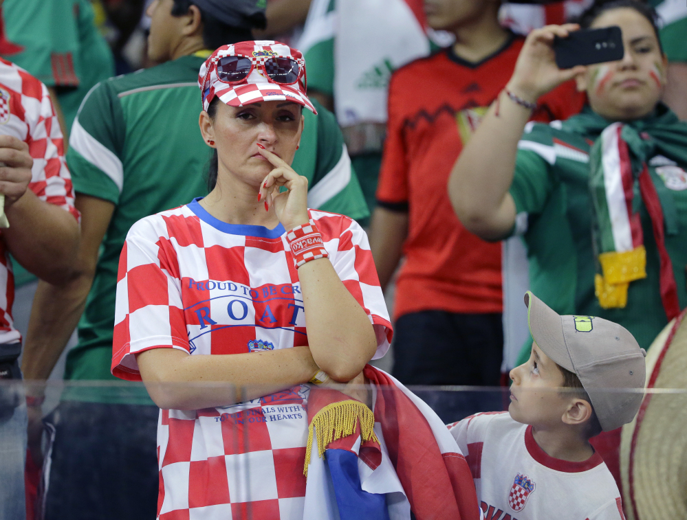 A Croatian fan reacts after the group A World Cup soccer match between Croatia and Mexico. Mexico won the match 3-1.