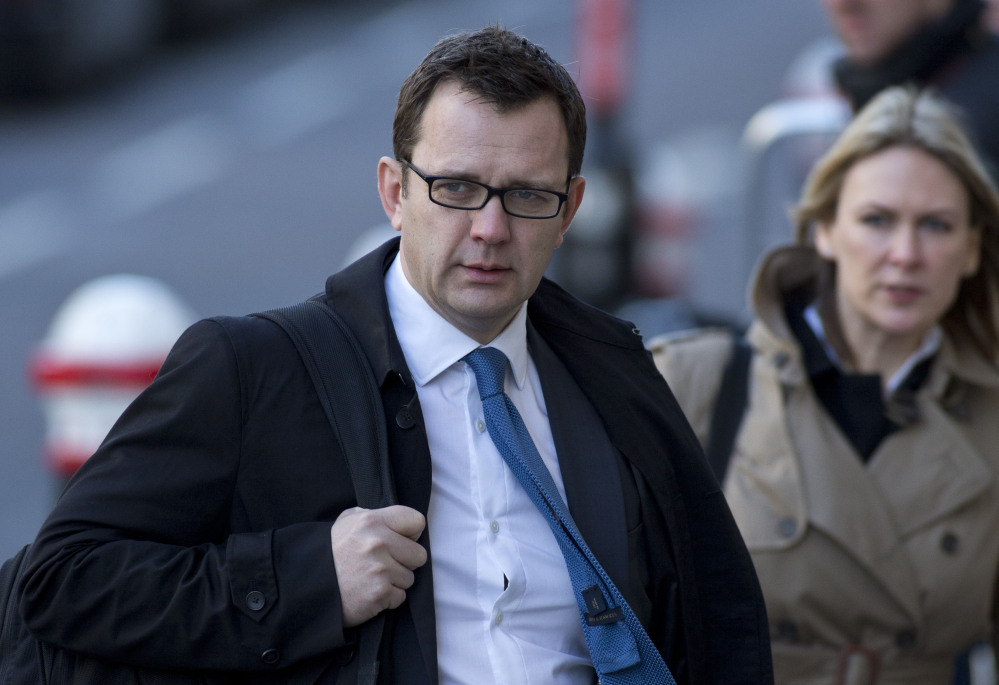 This is a  Friday, Feb.  21, 2014 file photo of Andy Coulson, former News of the World editor and former aide to British Prime Minister David Cameron arrives at the Central Criminal Court in London.