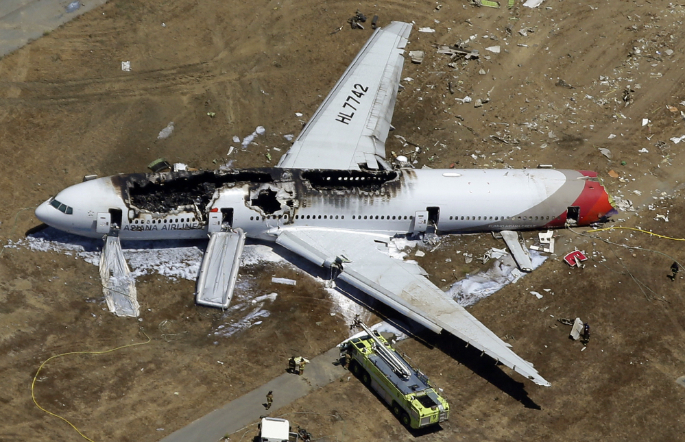 In this July 6, 2013 aerial file photo, the wreckage of Asiana Flight 214 lies on the ground after it crashed at the San Francisco International Airport in San Francisco.