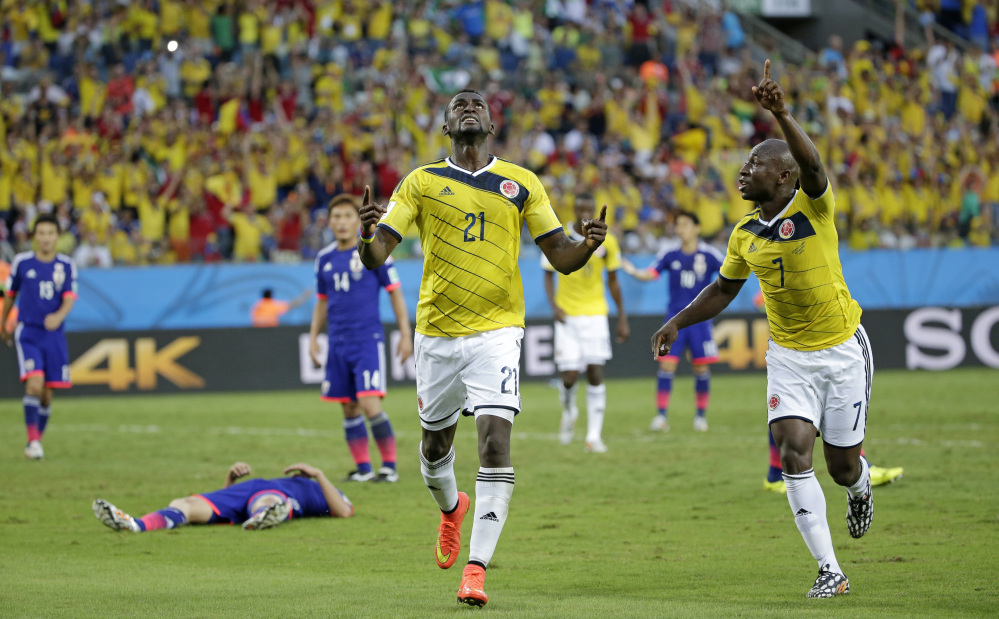 Colombia's Jackson Martinez celebrates after scoring his side's second goal during the group C World Cup soccer match between Japan and Colombia.