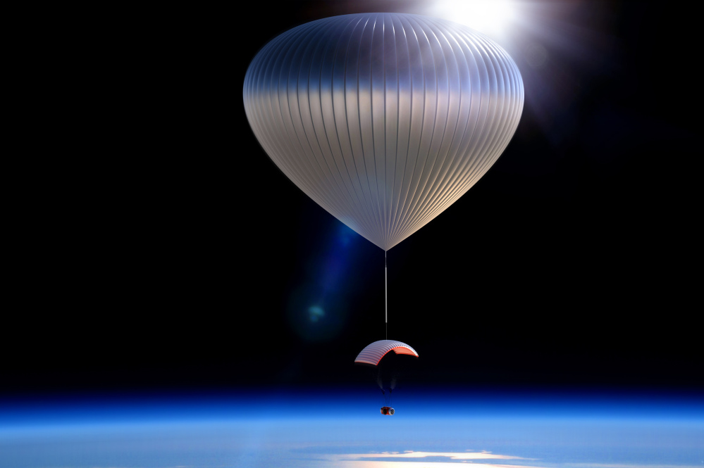 This artist rendering shows the World View Voyager pressurized space capsule that will be transported to the edge of space. World View Enterprises of Tucson, Ariz., is planning to begin its $75,000 per-person flights in 2016. The balloons will lift a capsule carrying six passengers and two crew members 20 miles up, where they will float under a parafoil for about two hours before floating back down to Earth.