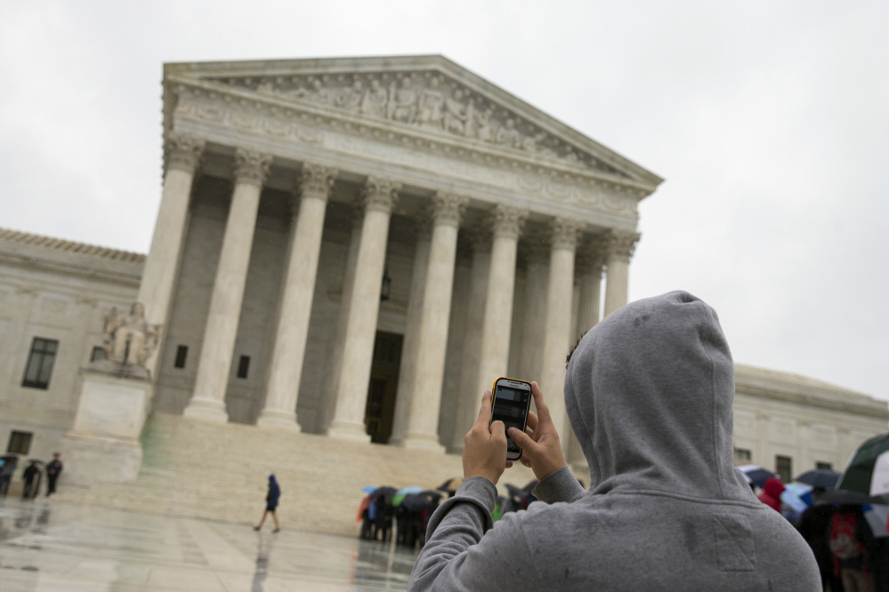 A unanimous Supreme Court says police may not generally search the cellphones of people they arrest without first getting search warrants. The justices say cellphones are powerful devices unlike anything else police may find on someone they arrest.