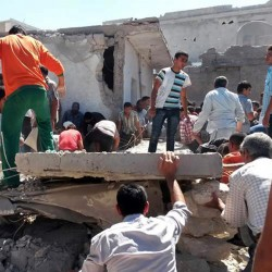 This photo provided by an anti-government activist group shows Syrians inspecting the rubble of destroyed houses following a Syrian government airstrike in Aleppo, Syria, on Wednesday. Syrian government warplanes on Wednesday struck a series of targets in a northern city that is a stronghold of an al-Qaida splinter group.