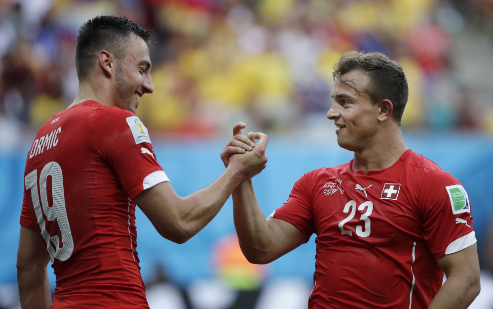 Switzerland's Xherdan Shaqiri, right, celebrates with teammate Josip Drmic after scoring his side's second goal during the group E World Cup soccer match between Honduras and Switzerland at the Arena da Amazonia in Manaus, Brazil, on Wednesday.