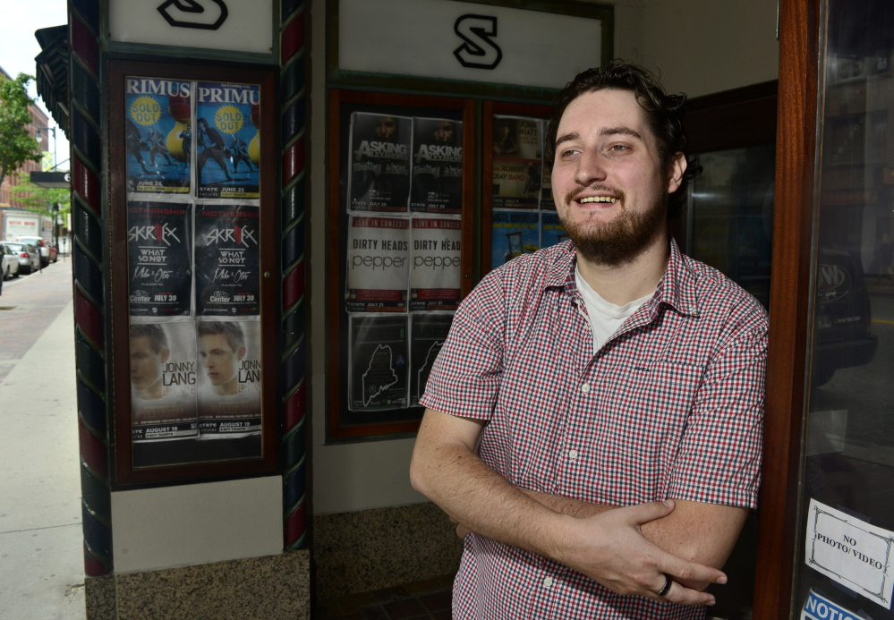 "Cody DeLong stands in front of the State Theatre in Portland on Wednesday. His company, Sound Rink, is growing as musicians look for ways to diversify their revenue streams. ""I could be anywhere, but I choose to be here,"" he said."
