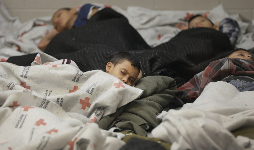 Children detainees sleep in a holding cell last week at a U.S. Customs and Border Protection processing facility in Brownsville, Texas.