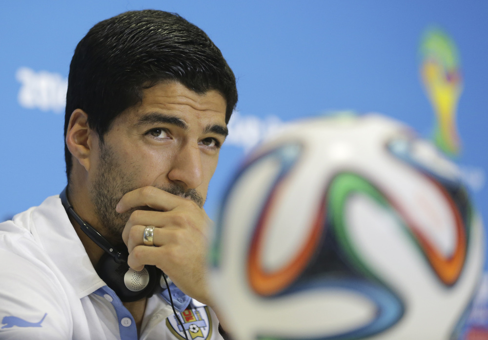 Uruguay's Luis Suarez listens to a question during a news conference at the Arena das Dunas in Natal, Brazil, on Monday.