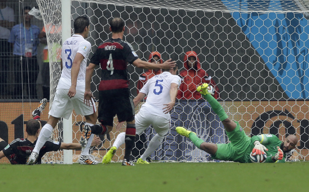 United States' goalkeeper Tim Howard, right, makes a save during the group G World Cup soccer match between the U.S. and Germany in Recife, Brazil, on Thursday.