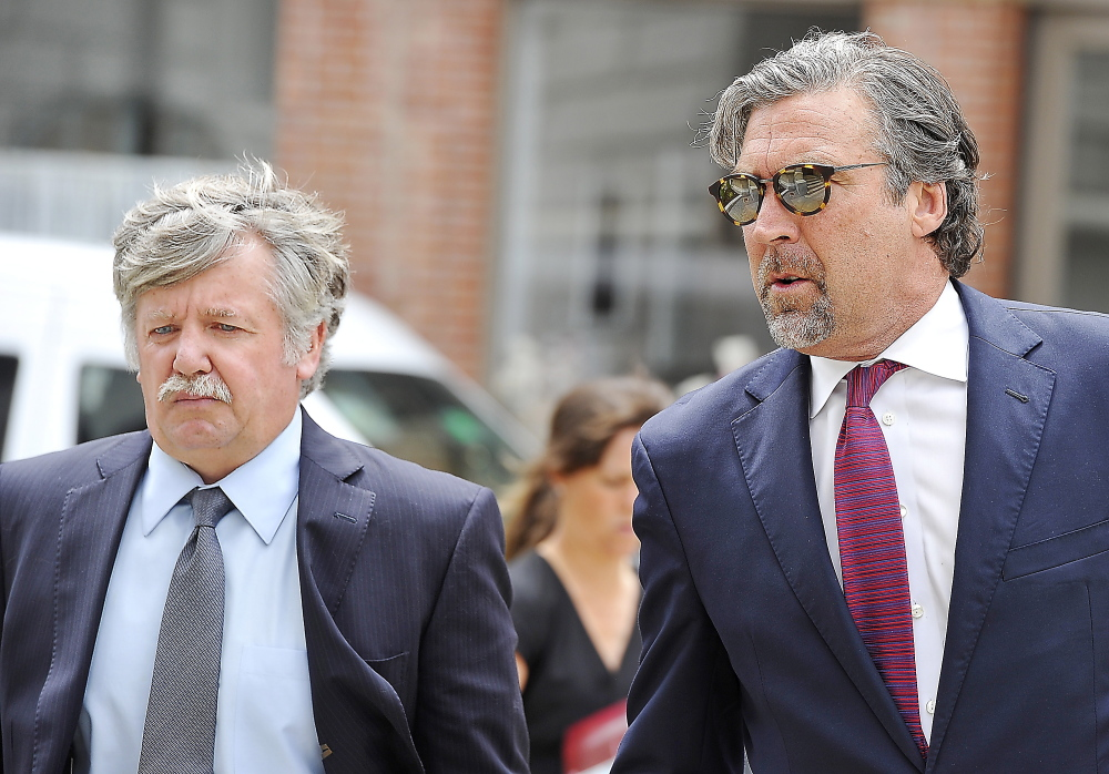 Walter Scott Fox III, 56, left, formerly of Cumberland, walks into the federal courthouse in Portland with attorney Thomas Hallett on Thursday.