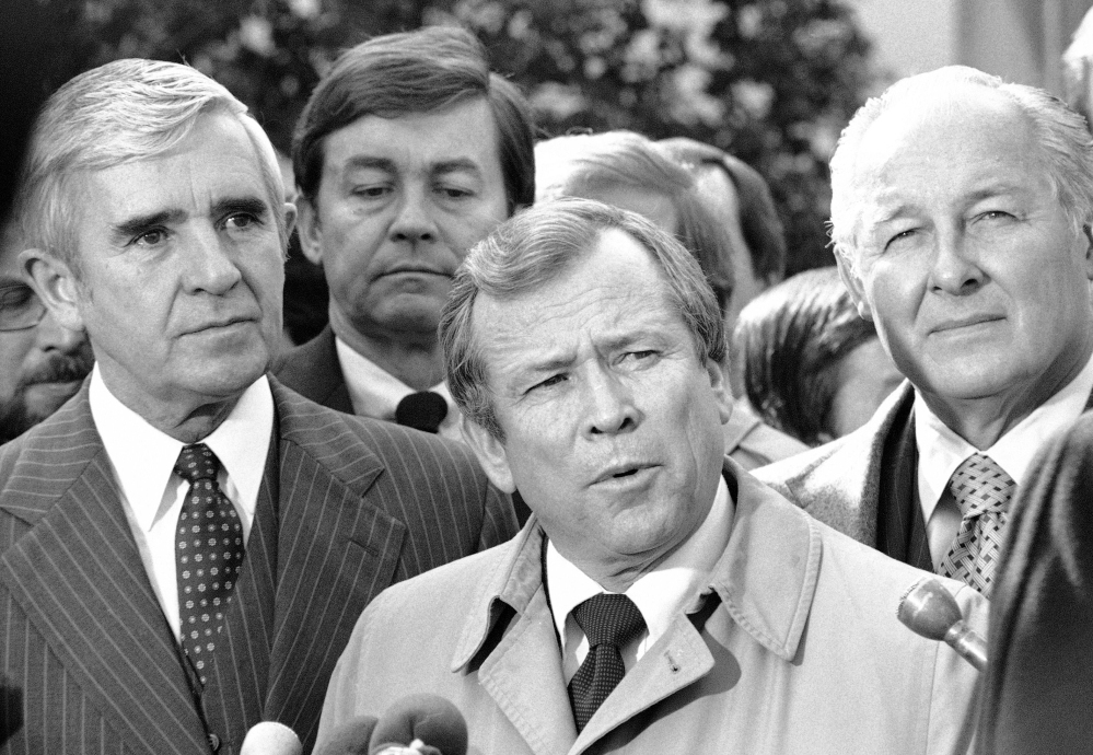 This 1982 photo shows Senate Majority Leader Howard Baker of Tennessee flanked by Sen. Paul Laxalt, R-Nev., left, and House Minority Leader Robert Michel of Illinois.