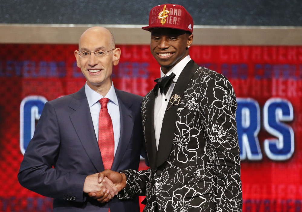 NBA Commissioner Adam Silver, left, congratulates Andrew Wiggins of Kansas, who was selected by the Cleveland Cavaliers as the No. 1 pick in the 2014 NBA draft Thursday in New York.