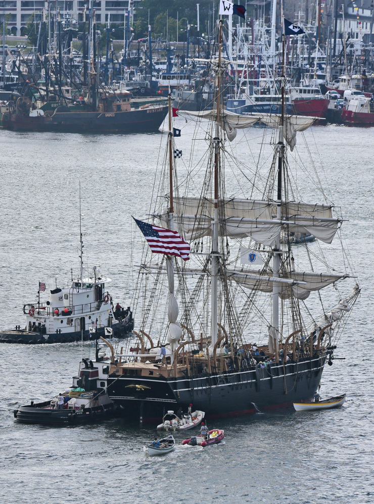 The whaling ship Charles W. Morgan approaches its berth in New Bedford, Mass., on Wednesday. The Charles W. Morgan, the last surviving ship from America's 19th-century whaling fleet, is undertaking a three-month journey along the southern New England coast.