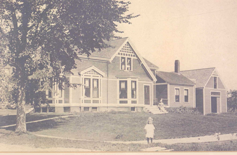 L.L. Bean's daughter, the late Barbara Bean Gorman, stands in front of the family's home at 6 Holbrook St. in Freeport in the early 1900s. L.L. Bean started his company and lived most of his life in the Queen Anne-style home.
