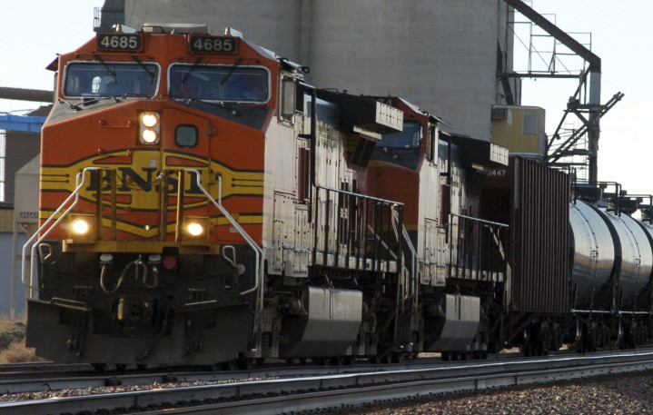 A BNSF Railway train hauls crude oil near Wolf Point, Mont., last year. Two congressmen from Oregon are calling for more disclosure on trains that are carrying crude oil.