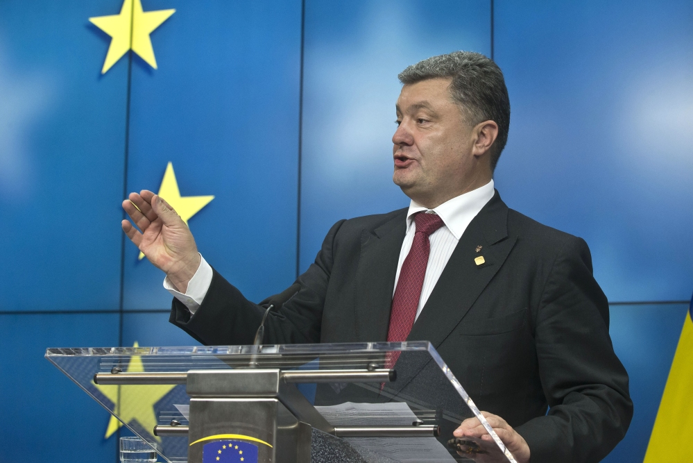 Ukrainian President Petro Poroshenko speaks during a news conference after a signing ceremony at an EU summit in Brussels on Friday.