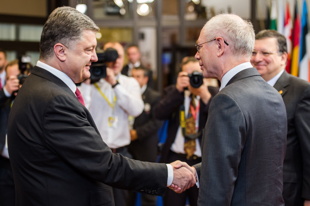 EU Council President Herman Van Rompuy, right, welcomes Ukraine's President Petro Poroshenko during a summit in Brussels on Friday.
