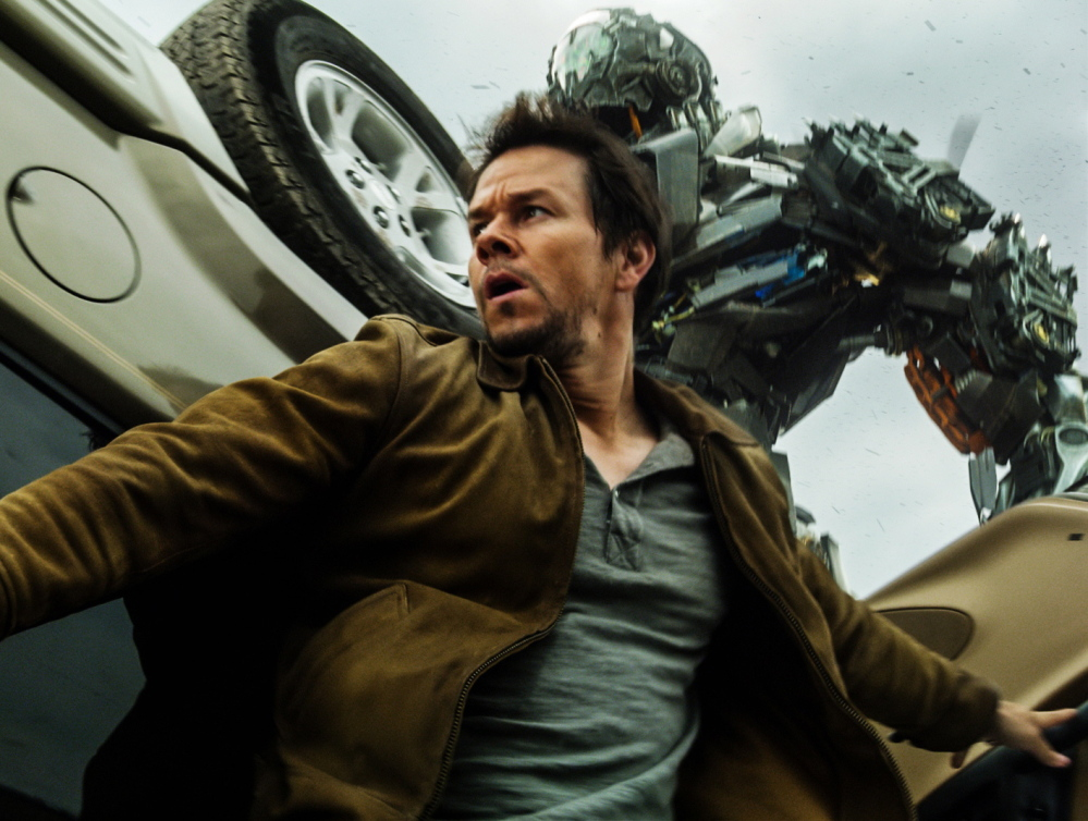 "Mark Wahlberg as Cade Yeager and the alien robot bounty hunter Lock Down in ""Transformers: Age of Extinction."""