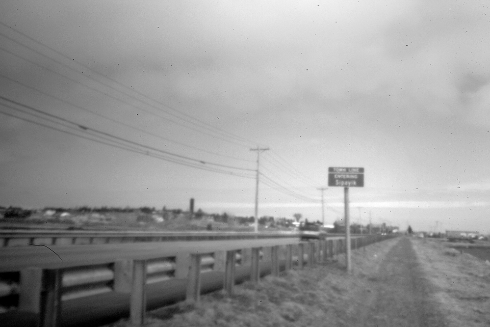 Captured in the early morning through the aperture of a pinhole camera recently, this stretch of road leads into Pleasant Point Indian Reservation, where a menacing situation developed late in 1965, when out-of-state hunters clashed with the native residents.