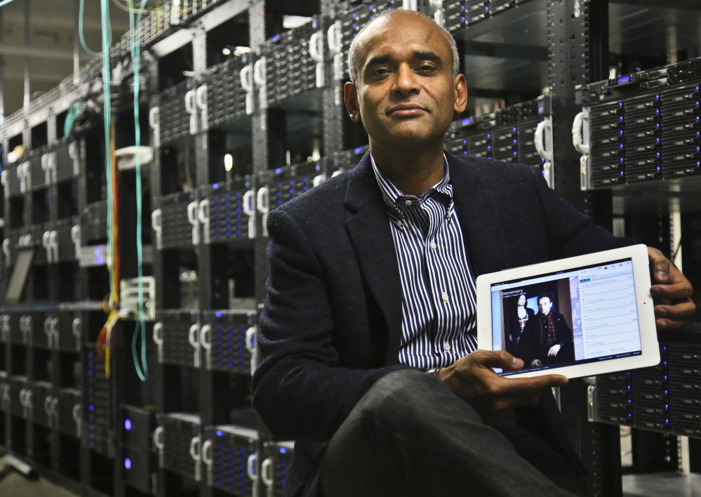 Chet Kanojia, Aereo founder and CEO, holds a tablet that uses his company's technology. The Supreme Court ruled last week that Aereo must pay broadcasters when it takes TV shows from the airwaves and lets subscribers watch them on smartphones and other devices.