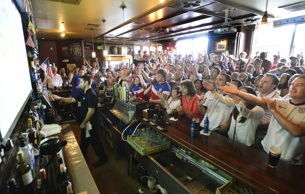 Standing room only as patrons at RiRa's watch USA vs. Germany during the World Cup Match from Brazil.