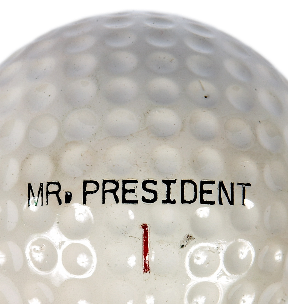 "A golf club, golf cart and a set of personalized ""Mr. President"" golf balls are on display at the museum."
