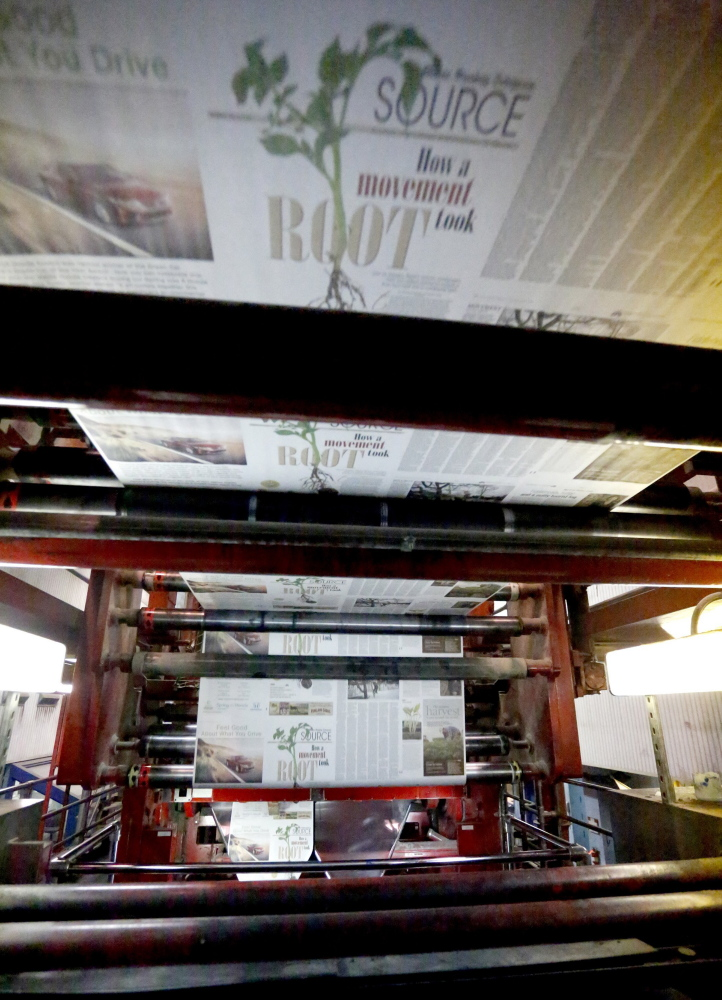 The first installment of Source rolls off the presses on April 3 at the Maine Sunday Telegram's printing plant in South Portland. The new section is one of many changes that are underway with the business.