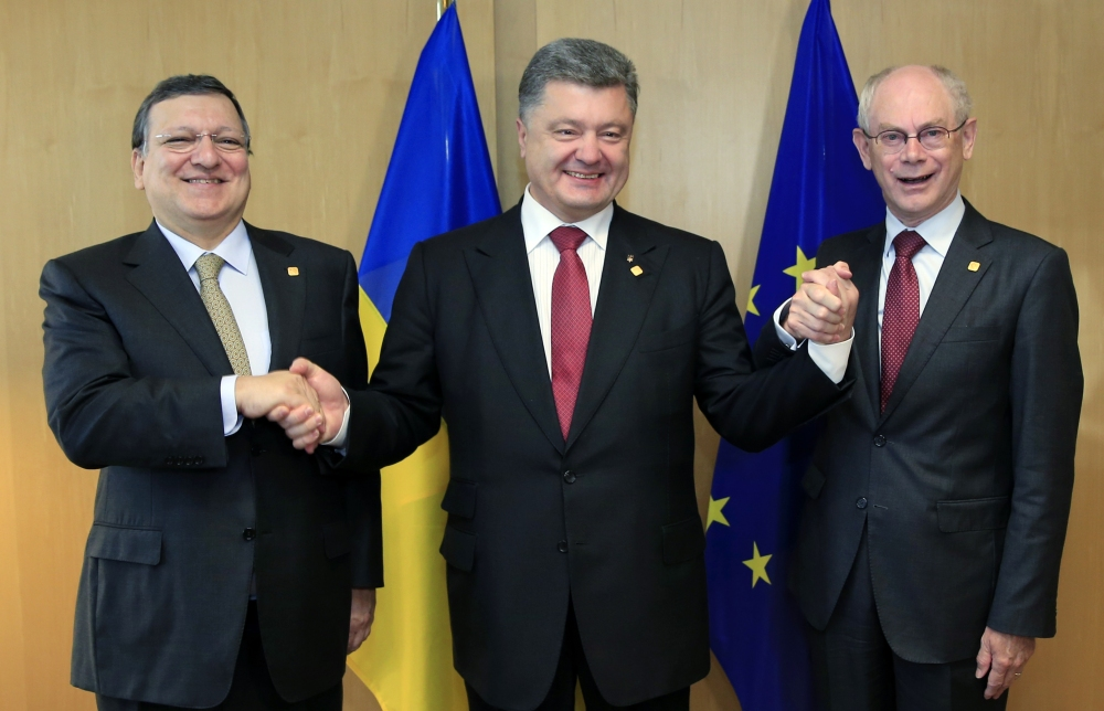Ukraine President Petro Poroshenko, center, poses with European Commission President Jose Manuel Barroso, left, and European Council President Herman Van Rompuy during a summit in Brussels on Friday.