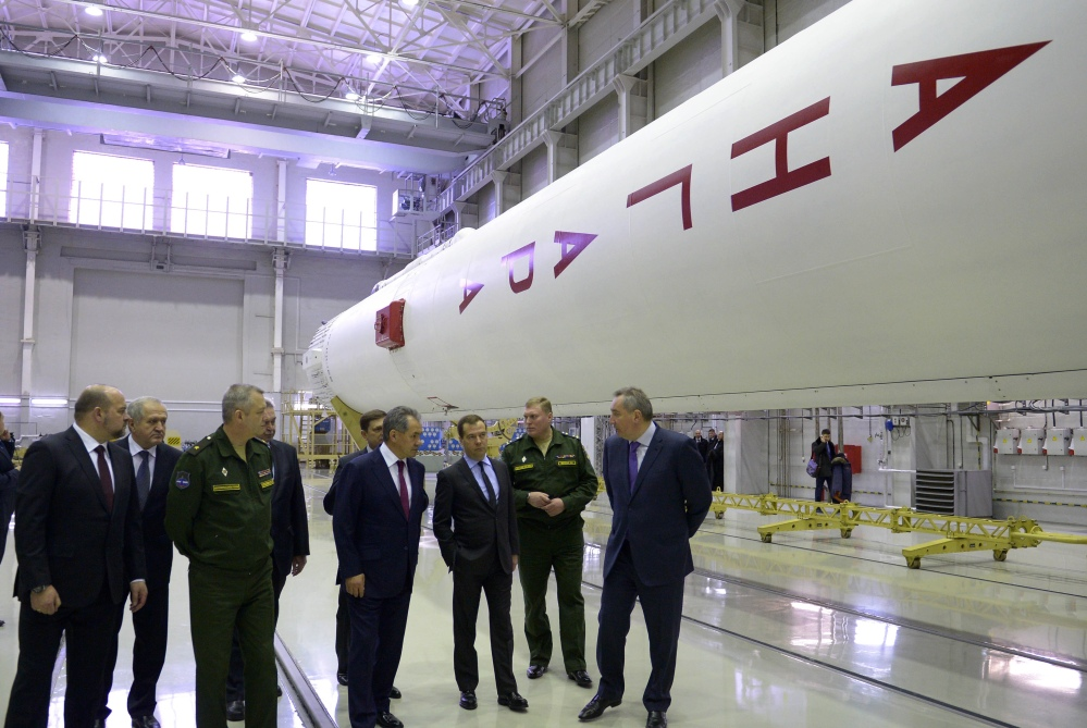 Russian officials visit an assembly shop, with the Angara booster rocket at right, at the Plesetsk Cosmodrome in northwestern Russia in February. Angara's first launch was aborted Friday by an automatic safety system moments before its blastoff from the Plesetsk launch pad.