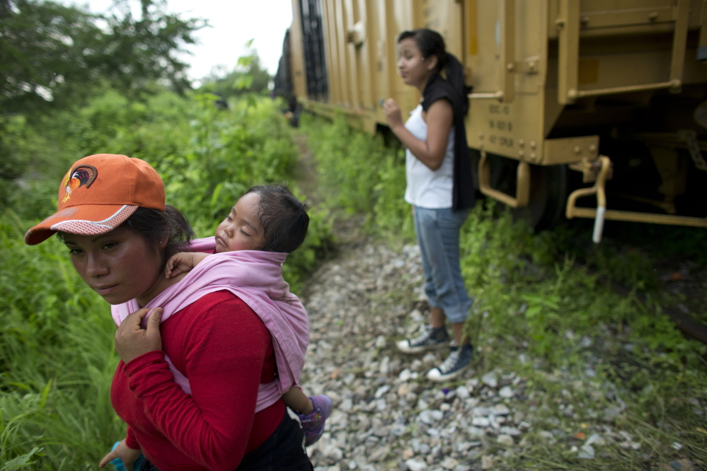 Guatemalan migrant Gladys Chinoy, 14, back right, said she was more excited about seeing her mother in the United States than she was scared about riding a train through Mexico. Her mother said the travel risks were worth taking after spending five years apart.