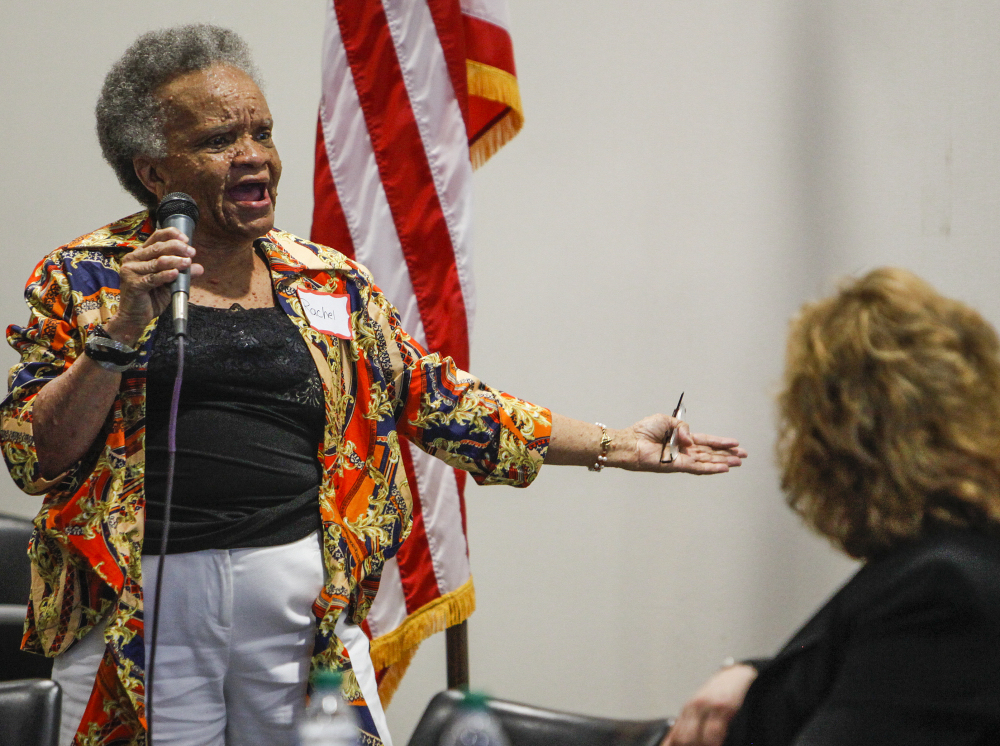 """Rachel Jamison, 66, left, of Memphis, addresses her concerns with the VA system at a town hall meeting. The system has a """"corrosive culture,"""" according to a presidential review."""