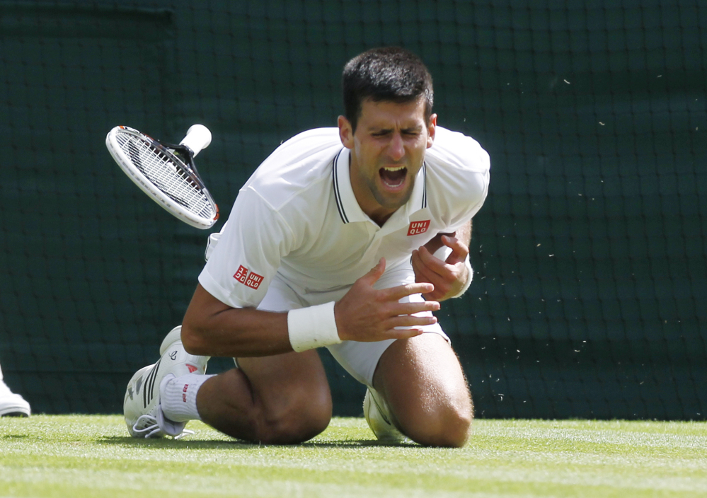 Novak Djokovic goes down in the third set, but a sore shoulder wasn't enough to keep the men's No. 1 seed from convincingly beating Gilles Simon on Friday in the third round at Wimbledon. Djokovic won 6-4, 6-2, 6-4 and will face Jo-Wilfried Tsonga on Monday.