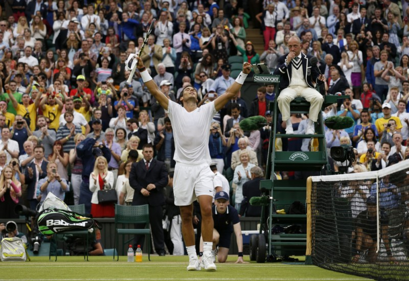 Rafael Nadal of Spain celebrates after defeating Mikhail Kukushkin of Kazakhstan in their men's singles match at the All England Lawn Tennis Championships in Wimbledon, London on Saturday.