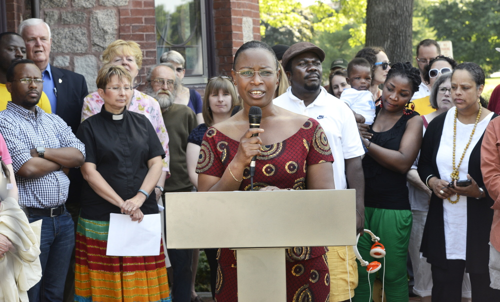 Suavis Furaha, an asylum seeker from Burundi, speaks during a news conference at Deering Oaks in Portland to protest Gov. Paul LePage's cuts to General Assistance to undocumented immigrants.