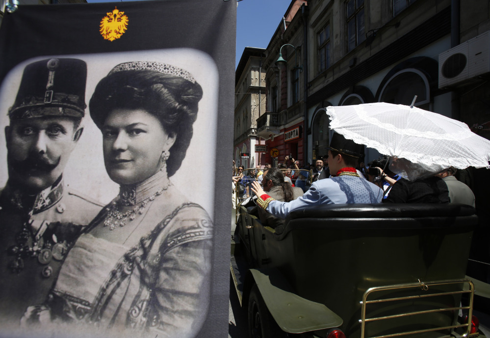 Tourists pose for photos inside a replica of the car where Gavrilo Princip assassinated Austro-Hungarian heir to the throne Archduke Franz Ferdinand, in Sarajevo on Saturday.