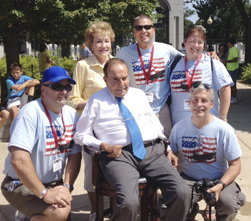 Bob and Elizabeth Dole meet Saturday with Honor Flight New England officials, including the group's founder, Joe Byron, right, at the World War II Memorial in Washington.