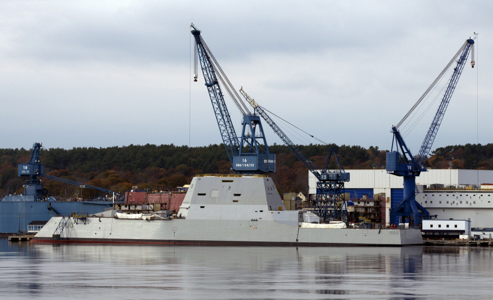 In this October 2013 photo, the Navy's stealthy Zumwalt destroyer is anchored at Bath Iron Works in Bath. Shipbuilders plan to bring military-grade jet fuel aboard the Navy's biggest destroyer in July, in preparation for lighting off some of the world's largest marine turbines for the first time.