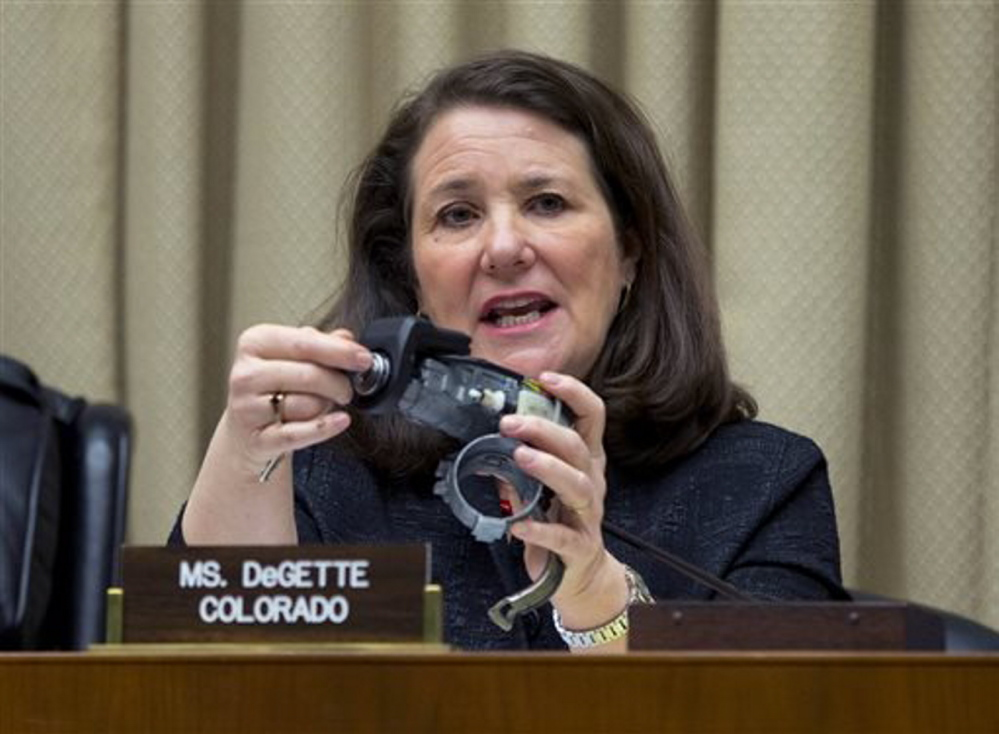 Rep. Diana DeGette, D-Colo., holds up a GM ignition switch while she questions General Motors CEO Mary Barra on Capitol Hill in Washington in April. DeGette, the ranking member of the House committee investigating GM's recall of 2.6 million small cars, wants General Motors to explain how it plans to fix what's been described as a lax corporate culture and how the company plans to compensate victims of crashes tied to faulty ignition switches.