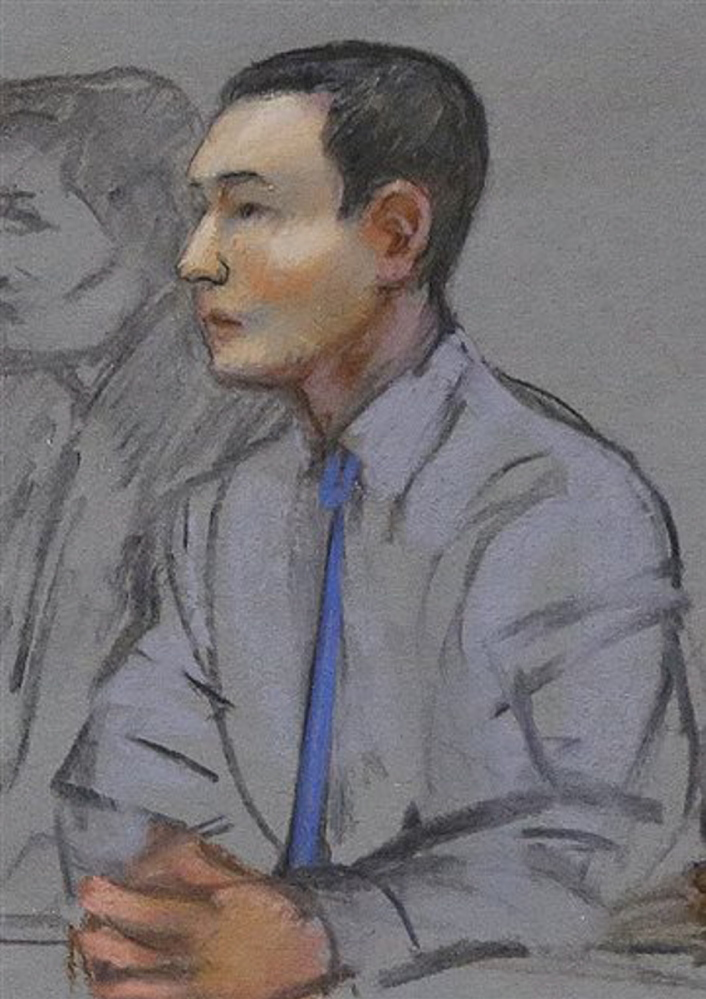 In this May 2014 courtroom sketch, defendant Azamat Tazhayakov, a college friend of Boston Marathon bombing suspect Dzhokhar Tsarnaev, sits during a hearing in federal court in Boston. Jury selection is set to begin Monday in Boston for his federal trial on obstruction of justice charges. Tazhayakov, of Kazakhstan, is accused with another friend of removing items from Tsarnaev's dorm room, but is not charged with participating in the bombing or knowing about it in advance.